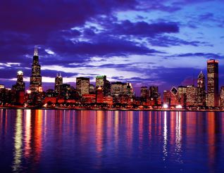 chicago skyline at sunset with purple clouds