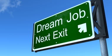 "A highway exit sign reads, ""Dream Job Next Exit."""